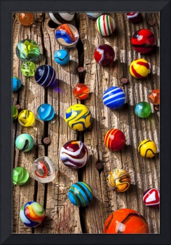 Marbles on wooden board