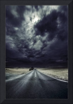 An asphalt road with stormy sky above, Tuscany, It