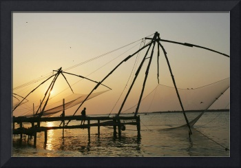Chinese Fishing Nets Hanging In The Water At Sunse