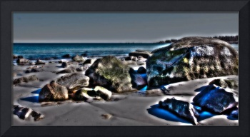 boulders on the beach , surreal