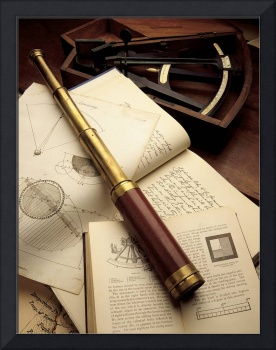Telescope on books and charts with octant