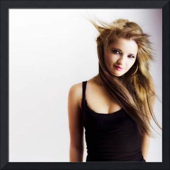Beautiful young girl with windswept hair