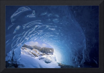 View from inside an ice cave looking outward at th
