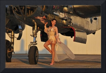 Beautiful 1940's pin-up girl standing with a B-25