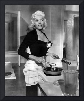 Jayne Mansfield showing off cooking skill