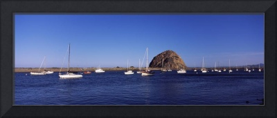 Boats at a harbor with rock in the background Mor