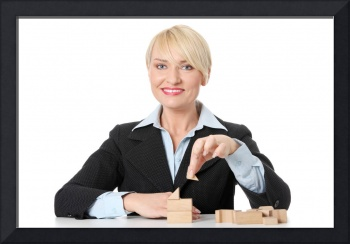 Mature businesswoman with blocks.