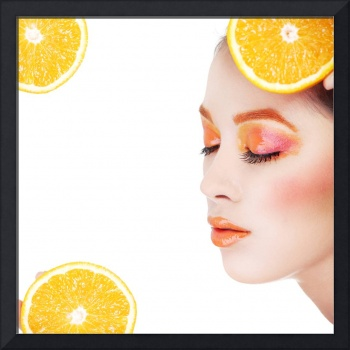 Young attractive woman with beautiful art orange a
