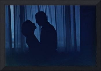 Blue silhouette couple kissing analogue film photo