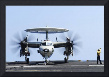 Aviation Boatswain's Mate directs an E-2C Hawkeye