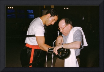 Rocky Marciano Looking at Glove