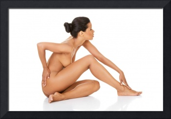 Beautiful and naked woman sitting. Side view. Legs