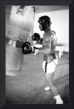 Muhammad Ali punching the heavy bag