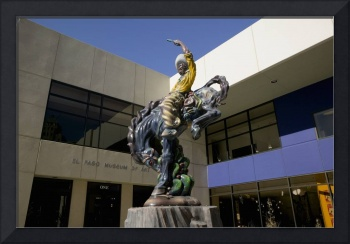 Low angle view of a statue of a cowboy on a bucki