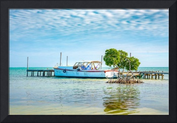 A boat at a pier on Caye Caulker in Belize