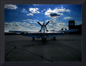 World War II fighter plane on runway with billowin