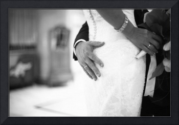 Bride and groom holding black and white wedding ph