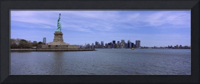 Statue Of Liberty with Manhattan skyline in the b
