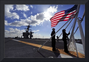 Sailors shift the colors aboard the aircraft carri