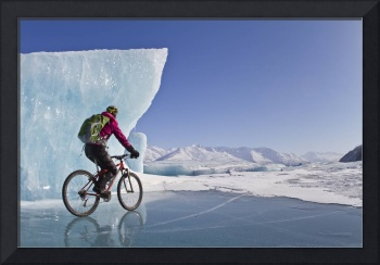 Woman Fat Tire Mountain Biking On Ice At The Knik