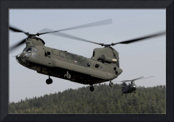 Two CH-47 Chinook helicopters in flight