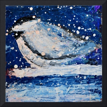 Chickadee bird at nightfall in snowstorm