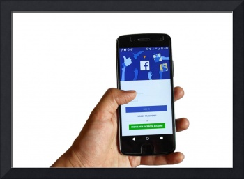 hand with facebook app