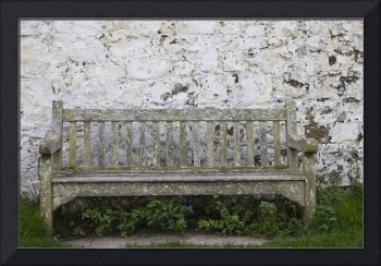 A Wooden Bench With Peeling Paint Against A White