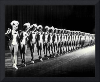 Gorgeous Rockettes pose for picture on stage