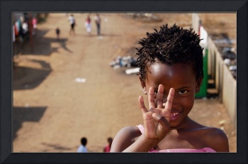 South African girl waving goodbye