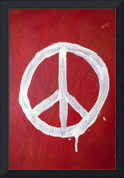 Peace sign on red wooden wall