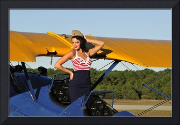 Patriotic pin-up girl standing inside the cockpit