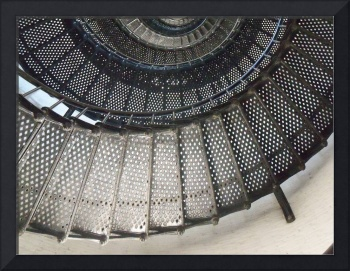 Looking up into a large spiral staircase