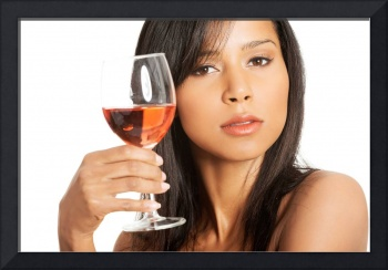 Portrait of young happy beautiful woman with glass