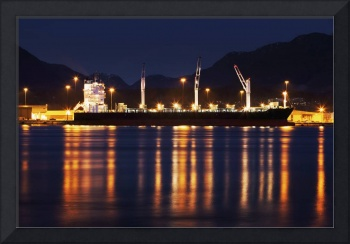 Cargo Ship loads at night in Vancouver photograph