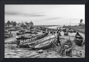 Fishing boats stranded in mud during low-tide
