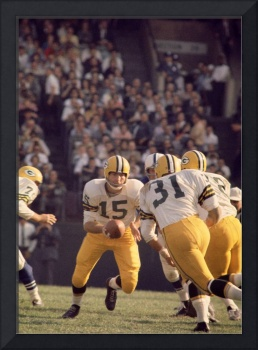 Bart Starr hands off to Jim Taylor