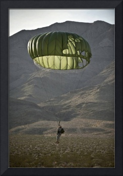Soldier prepares to land after a static-line jump