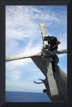 Aviation Machinist Mate conducts maintenance on th