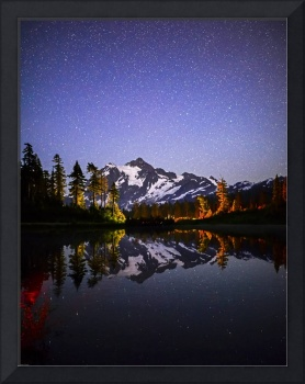 Mt. Shuksan under stars reflected in Picture Lake