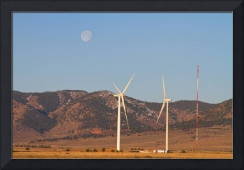 Wind Turbines with a Full Moon and Blue Skies