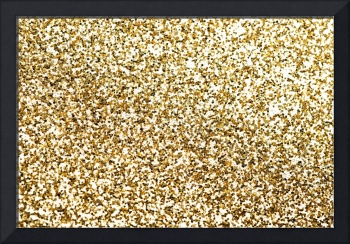 Gold pieces of confetti. Up front view.