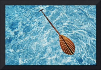 Overhead View Of Paddle Floating On Surface Of Tur
