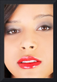 Beautiful woman's face in closeup with red lipstic