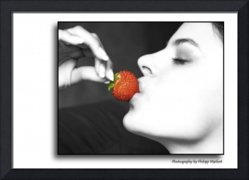 women kissing a red strawberry