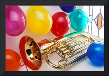 Tuba in window with ballons