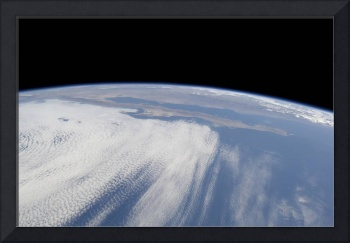 Heavy cloud cover over the Pacific Ocean.
