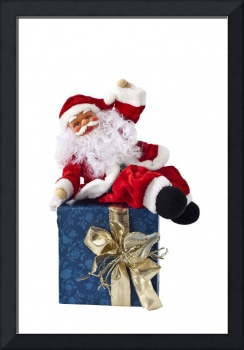Santa Claus sitting on a parcel