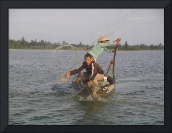 Fisherman casting net in Hoi An