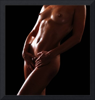 Oiled body of nude woman in the dark